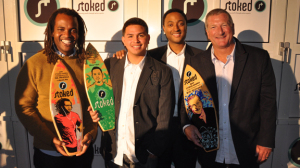 Sal Masekela, mentee Erick Tobar, Stoked founder Steve Larosiliere, and 2009 Achievement Award recipient, Quiksilver CEO Bob McKnight at the 2009 Stoked Awards